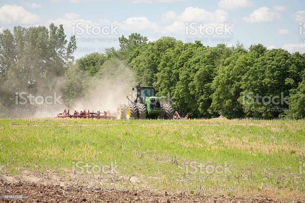 John Deere Field Tilling stock photo