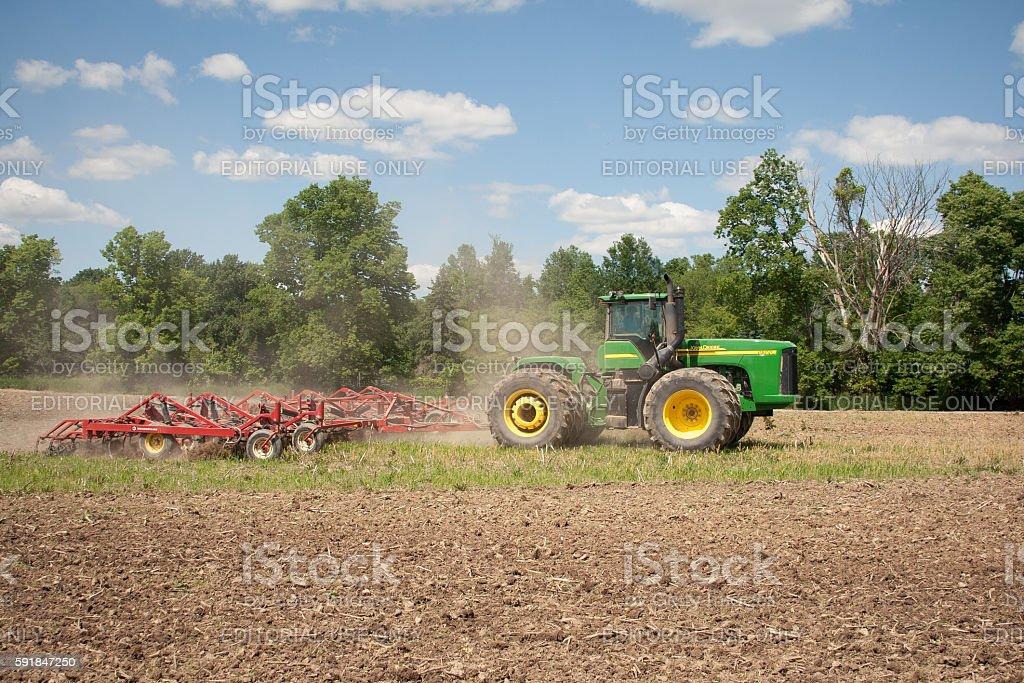 John Deere Plowing Field stock photo