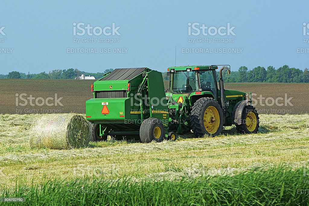 John Deere Tractor and Silage Baler stock photo