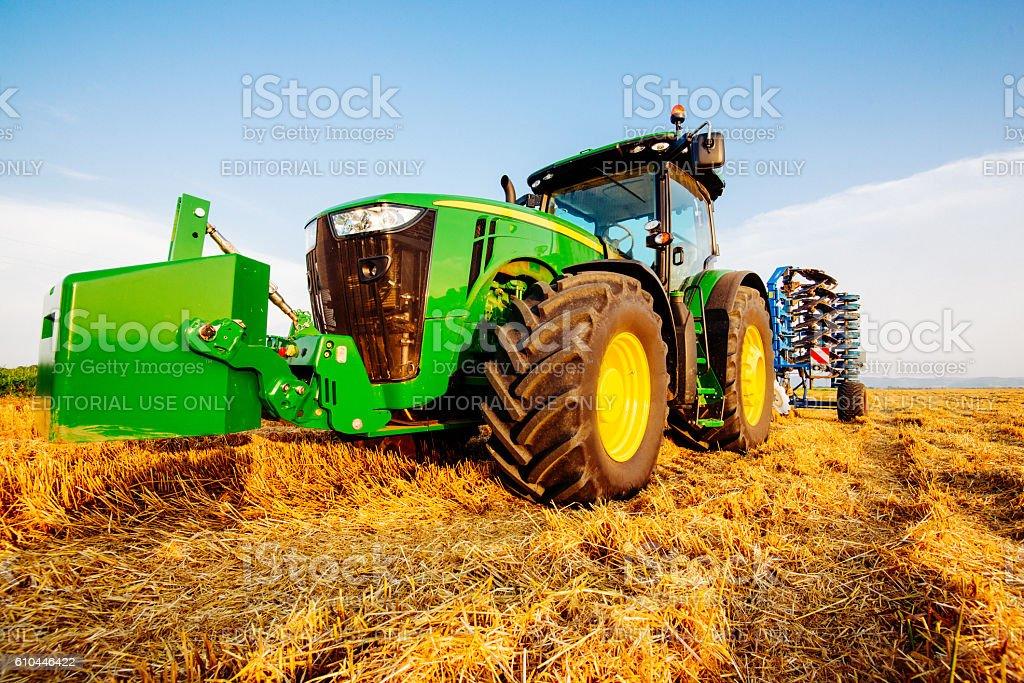 John Deere tractor with plow stock photo