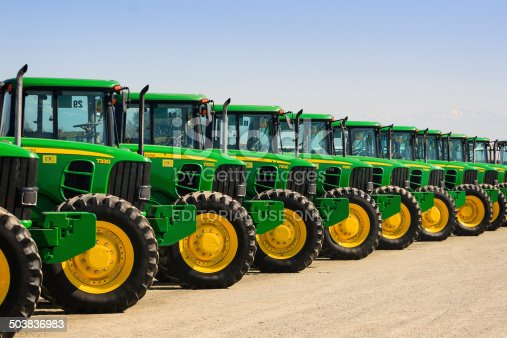 Tulare, CA, USA - February 11, 2011: A row of John Deere farm tractors wait to be sold to the highest bidder at a Ritchie Bros Auction.