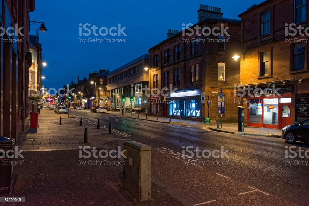 KILMARNOCK TOWN, SCOTLAND - SEPTEMBER 18, 2017: John Finnie St at night, a highly popular street in kilmarnock. stock photo
