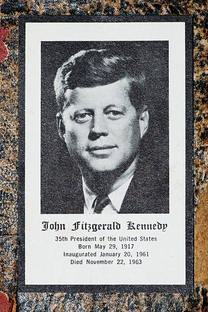 John Fitzgerald Kennedy funeral prayer obituary card Borgosesia, Italy - September 4, 2011: John Fitzgerald Kennedy funeral prayer obituary card, studio shot of the card on an old book cover. Printed by Jefferies & Manz Inc. Phila., Pa. us president stock pictures, royalty-free photos & images