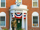 Hyannis, USA - September 5, 2007: John Fitzgerald Kennedy Museum. The museum is in Hyannis, Cape cod, Massachusetts. Statue of JFK is in foreground.
