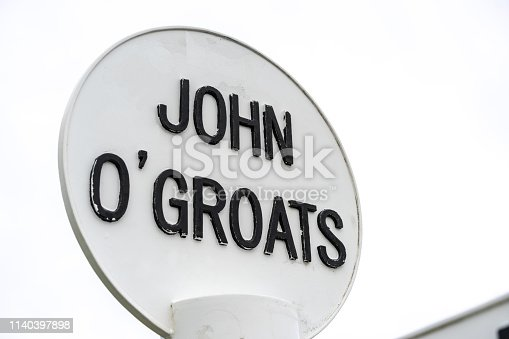 A sign for the village of John o'Groats, located in the far north east of Scotland, and famous as the destination point from Landsend in the south west of England.