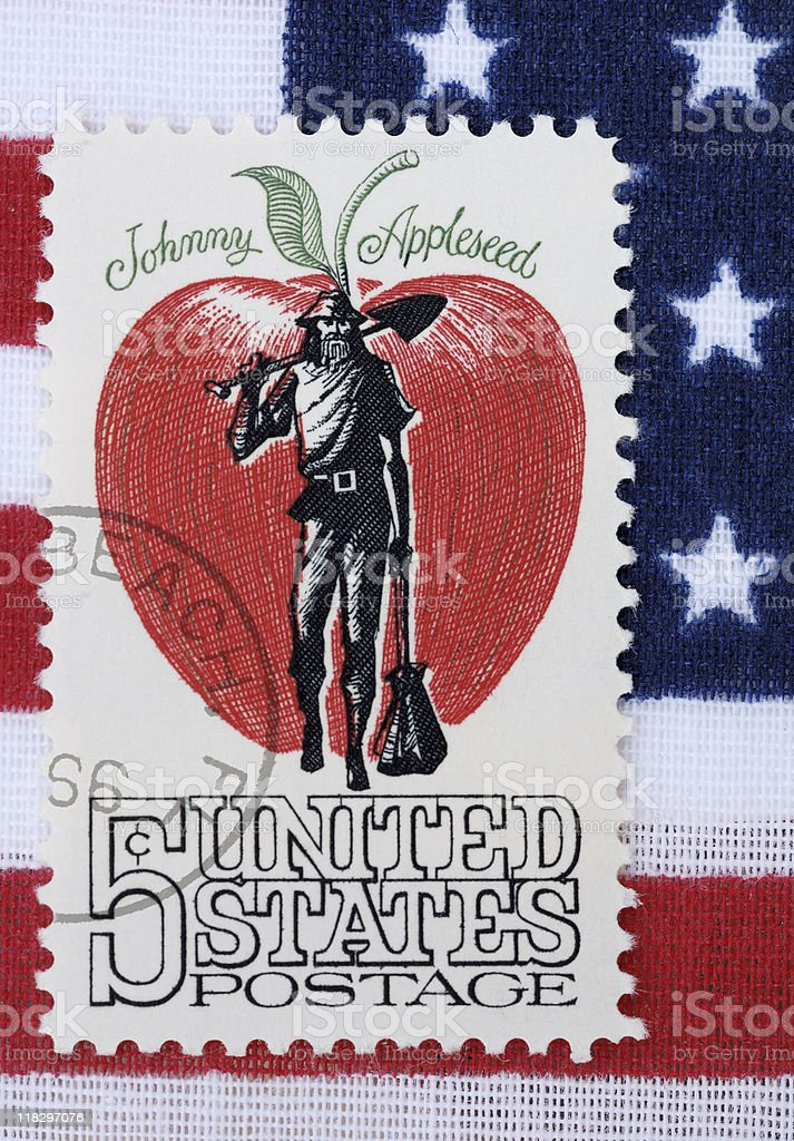 Johnny Appleseed 5 cent stamp on American flag background stock photo