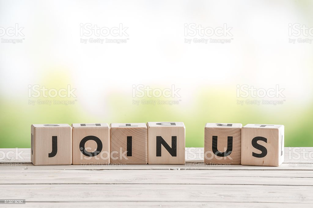 Join us sign on wooden cubes stock photo