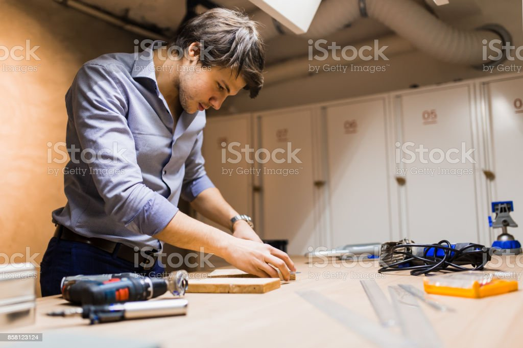 Joiner working and designing on workbench stock photo