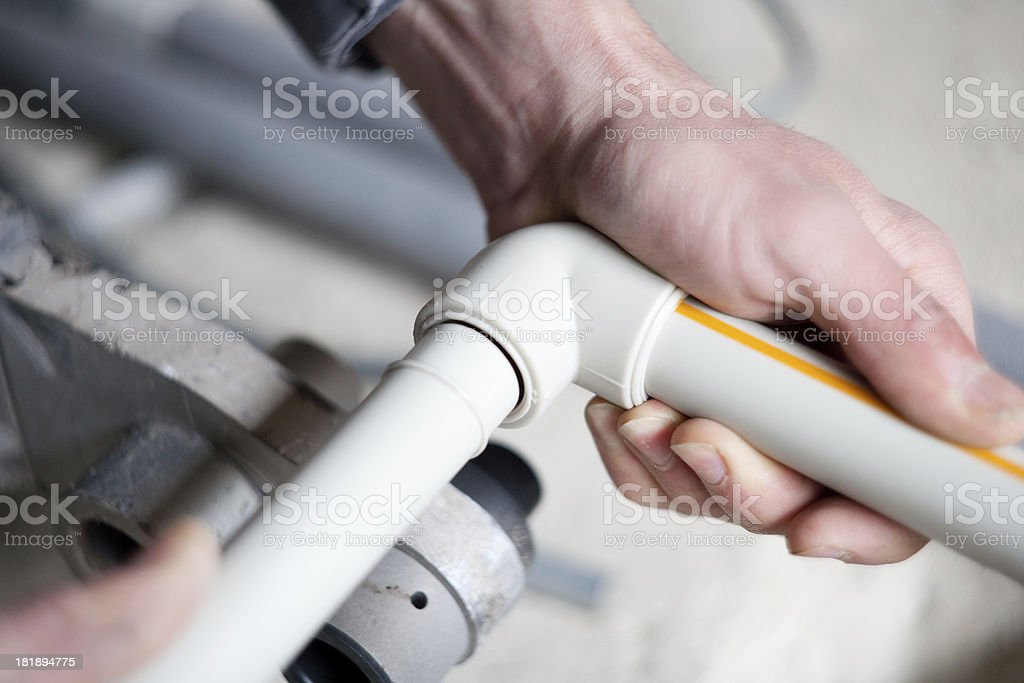 Joining plastic pipe stock photo