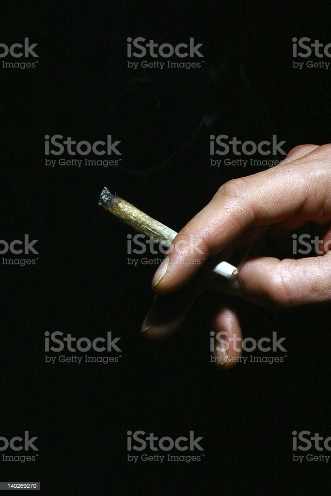 Joint in Hand stock photo