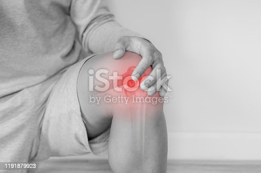 istock Joint pain, Arthritis and tendon problems. a man touching nee at pain point 1191879923