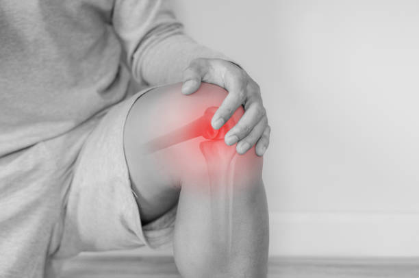 Joint pain, Arthritis and tendon problems. a man touching nee at pain point Joint pain, Arthritis and tendon problems. a man touching nee at pain point joint pain stock pictures, royalty-free photos & images