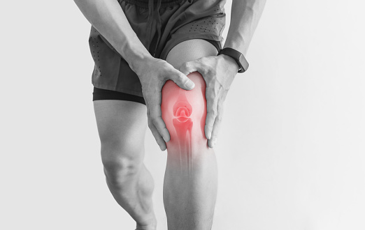 Joint pain, Arthritis and tendon problems. a man touching nee at pain point, on white background