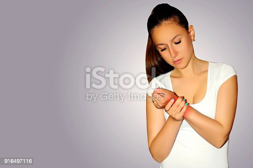 istock Joint pain. Young woman suffer with wrist pain. Sprain pain location indicated by red spot. 916497116