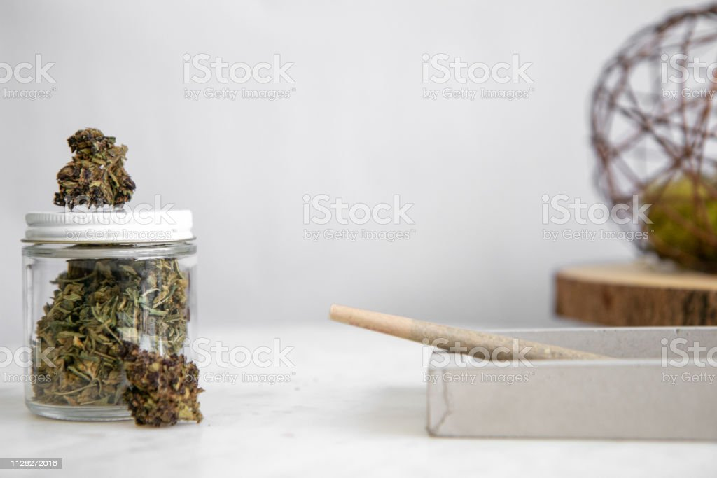 Joint, Shake, Buds, Glass Jar - Cannabis Dispensary Products stock photo