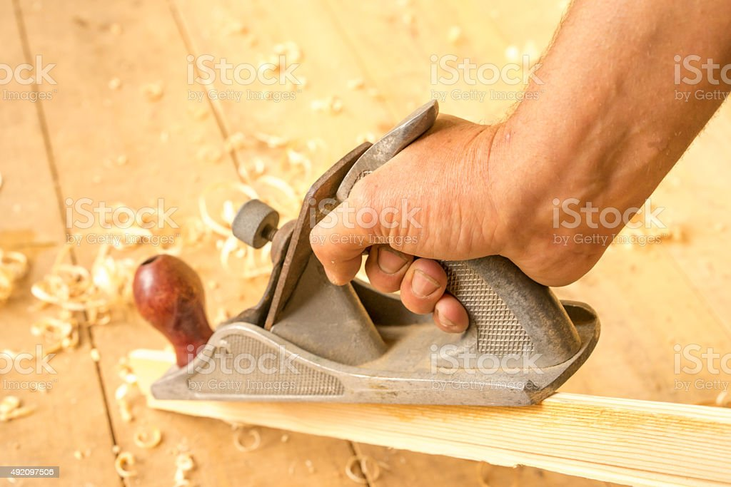 jointer in a worker hand stock photo