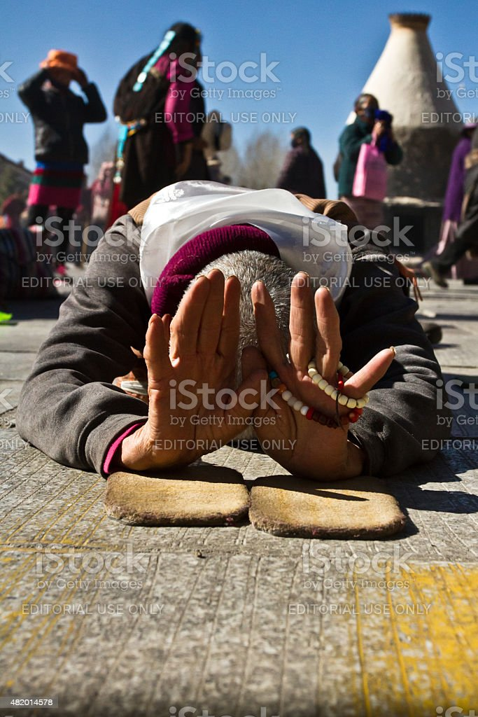 Jokhang Temple and Barkhor Square and its Devotees Lhasa Tibet stock photo
