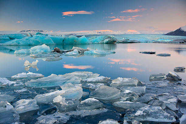 Jokulsalon Glacial lagoon A tranquil sunset at Jokulsarlon, Iceland. jokulsarlon stock pictures, royalty-free photos & images