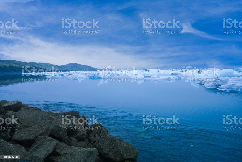 Jokulsarlon Ice Beach with numerous white crystal iceberg floating in Turquoise sea , Vatnajokull, Iceland stock photo