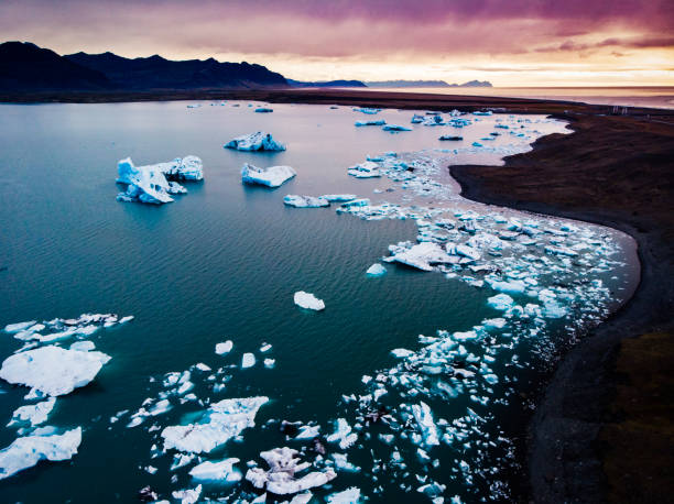 Jokulsarlon Lagoon Icebergs in Iceland Jokulsarlon Lagoon is famous because of the beautiful icebergs that float in this lagoon formed from the diminishing glaciers in Iceland. In the last thirty years this lake has increased a lot in size because of the acceleration of the glaciers melting affected by the global warming. jokulsarlon stock pictures, royalty-free photos & images