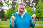 Jolly excited plus sized woman celebrating triumph