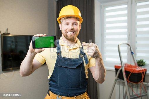 istock Jolly repairman recommending mobile app 1083903856