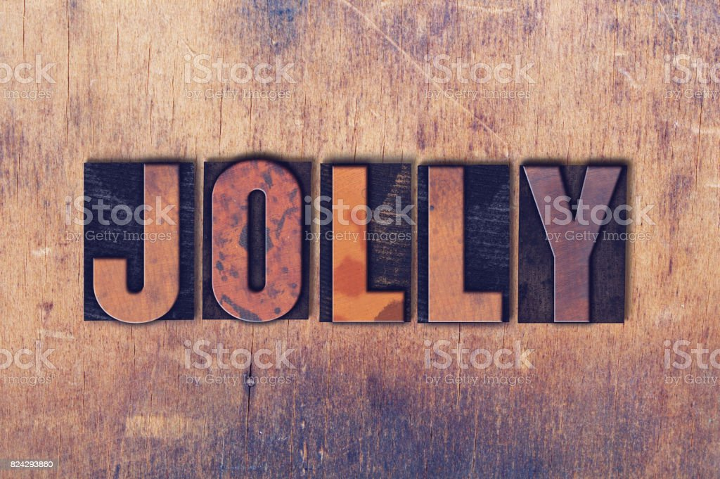 Jolly Theme Letterpress Word on Wood Background stock photo