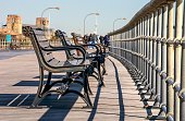 A row of benches on the boardwalk at Jones Beach State Park in Wantagh, Long Island, New York.