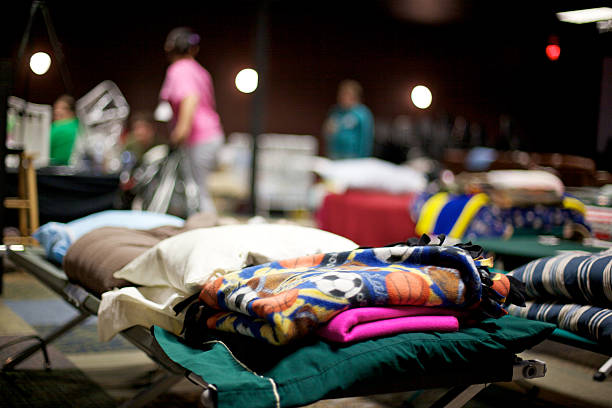 Joplin Missouri deadly F5 Tornado homeless shelther Joplin, United States - May 25, 2011: Public shelther cots where homeless residents stay only a few days following a destructive and deadly F5 tornado May 22, 2011 eyecrave stock pictures, royalty-free photos & images