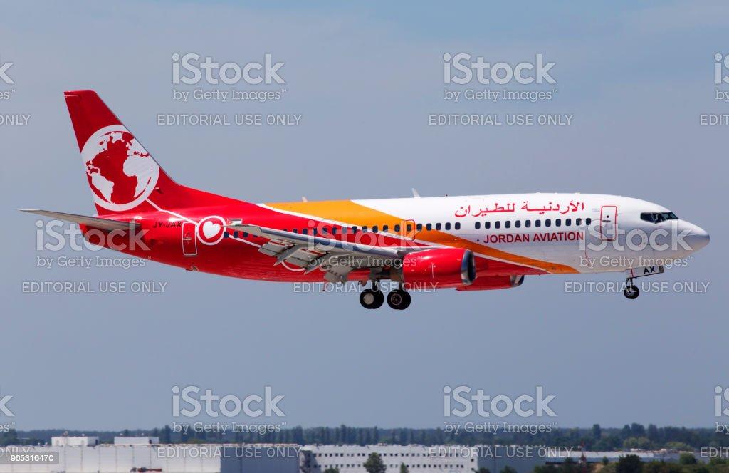 JY-JAX Jordan Aviation Boeing 737-300 aircraft landing on the runway royalty-free stock photo