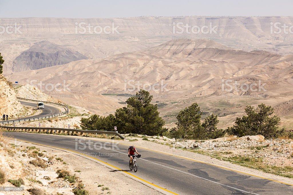 Jordan desert asphalt biking royalty-free stock photo