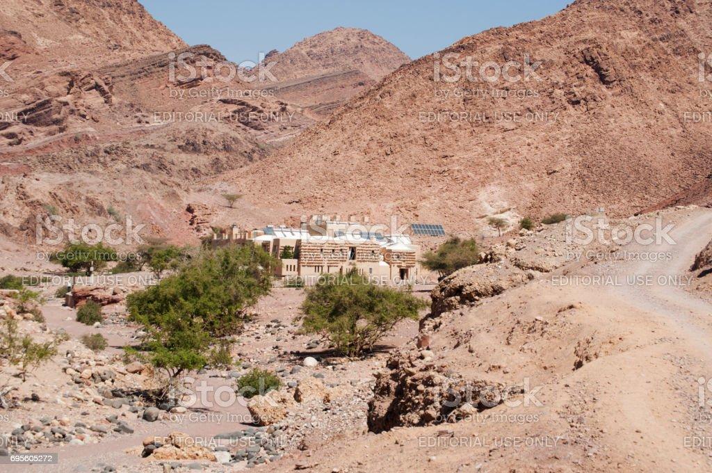 Jordan: desertic landscape with view of Feynan Eco Lodge, a solar powered retreat in the Dana Biosphere Reserve, part of The Royal Society for the Conservation of Nature stock photo