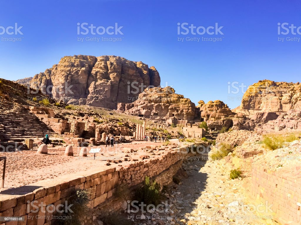Jordan Petra desert panorama with a toms in the distance and blue sky above. Temple and tombs visible stock photo