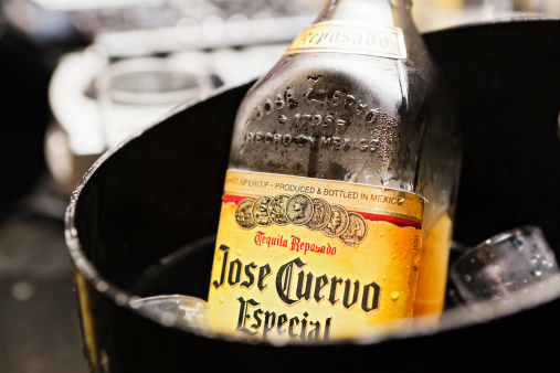 Cape Town, South Africa - April 2, 2010: A bottle of Jose Cuervo Especial tequila chills in a bucket of ice, ready for the party tp begin.