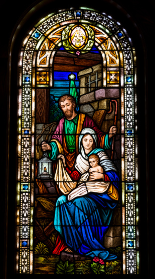 Holy family in stained glass window of a church