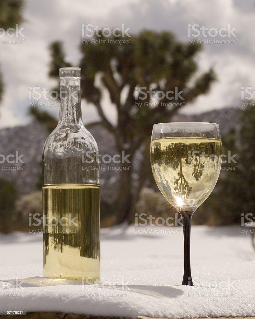 Joshua Tree Chardonnay Wine Glass Bottle Inverted Image Snow Desert stock photo