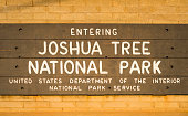 Joshua tree national park  sign at entrance when sunset,California,usa. at sunset,California,usa.