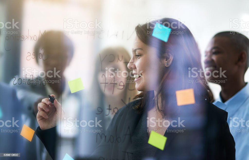 Jotting some ideas down stock photo