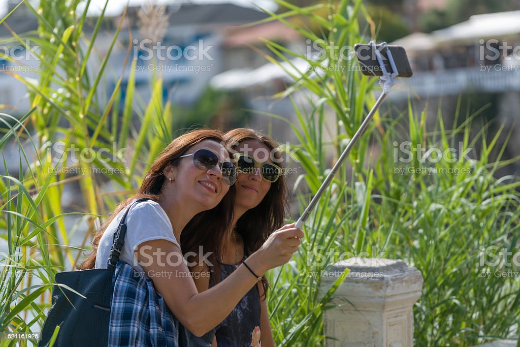 joung womens make selfie in Antique city side stock photo