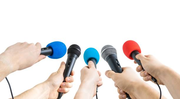 Journalism and conference concept. Many reporter hands hold microphones. Isolated on white background. stock photo