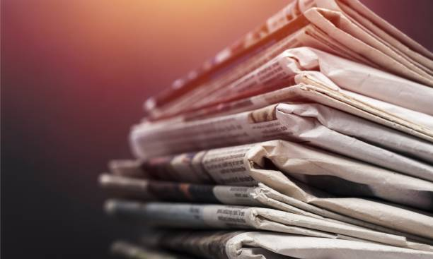 Journalism. Pile of newspapers on white background newspaper stock pictures, royalty-free photos & images