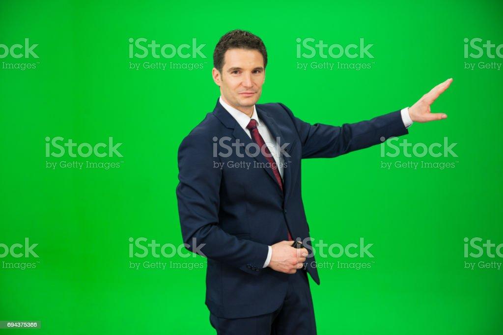 Journalist against green background stock photo
