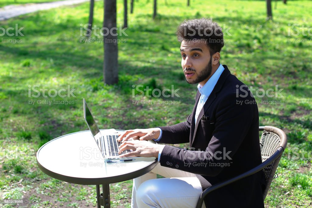 Journalist finished work in park stock photo
