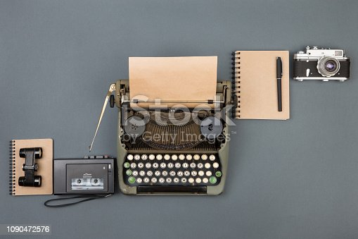 istock Journalist or private detective workplace - typewriter, camera, recorder and other stuff 1090472576