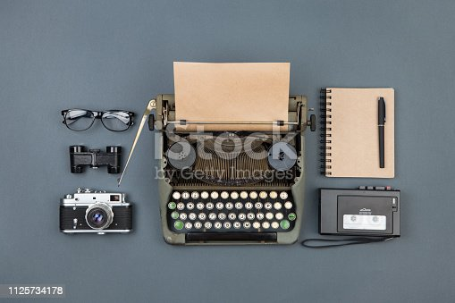 istock Journalist or private detective workplace - typewriter, camera, recorder and other stuff 1125734178