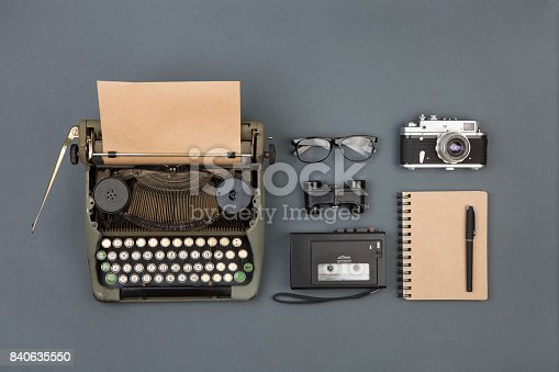 istock Journalist or private detective workplace - typewriter, camera, recorder and other stuff 840635550