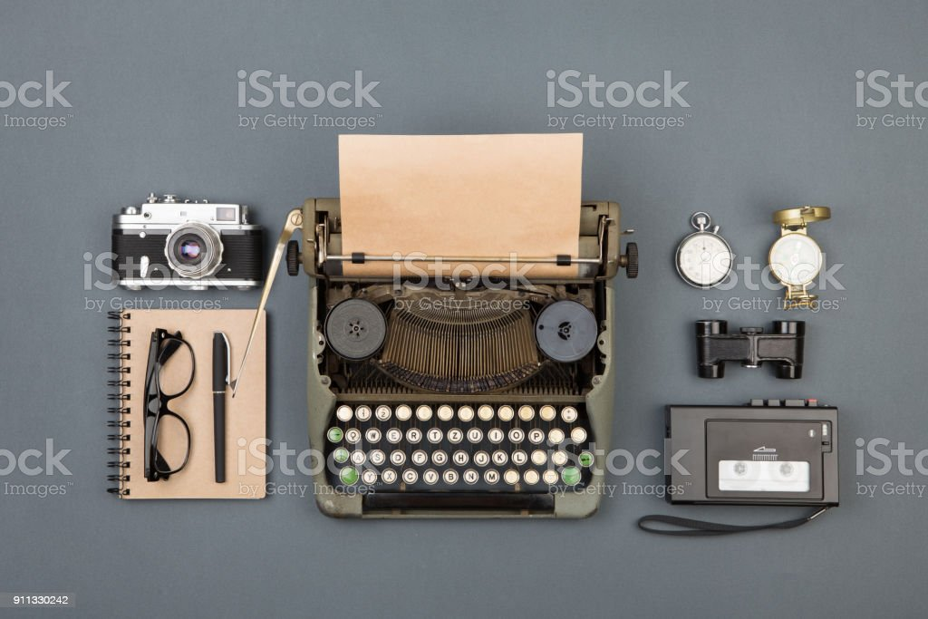 Journalist or private detective workplace - typewriter, camera, recorder and other stuff stock photo