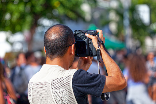 Saint-Gilles les bains, La Réunion - June 25 2017: Reporter taking a picture of the crowd during the carnival of the Grand Boucan.
