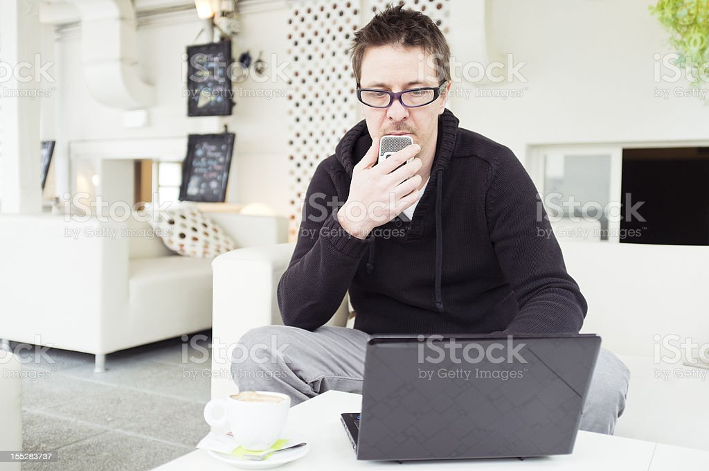 Journalist with laptop and dictaphone stock photo