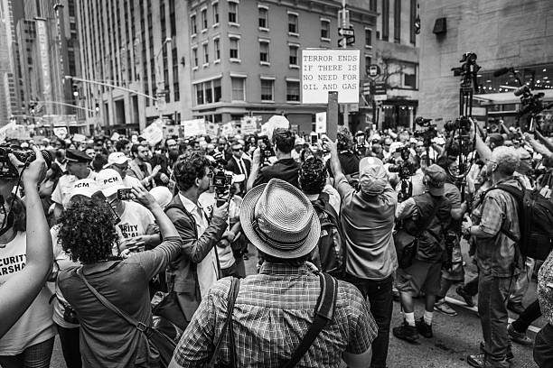 Journalists crowd around celebrities in People Climate March stock photo